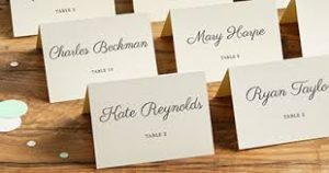 These are the standard tent cards you see at most weddings. They sit on a table in alphabetical order for each couple to take their name to know where to sit.